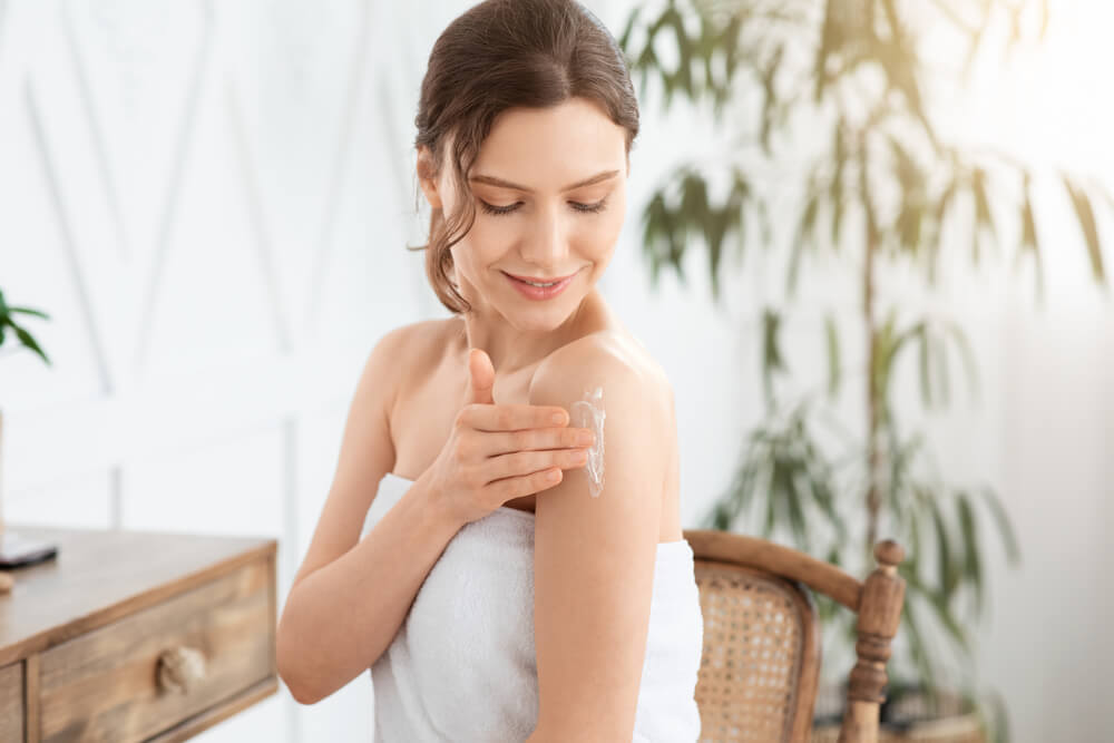 Woman applying Revitalizing Body Butter