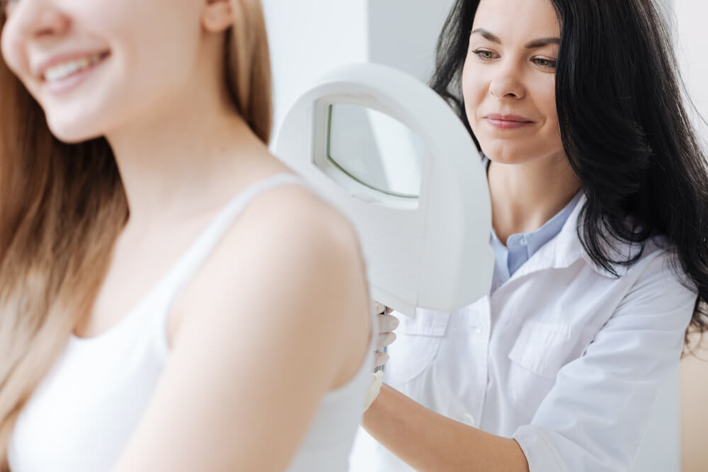 Dermatologist examining woman