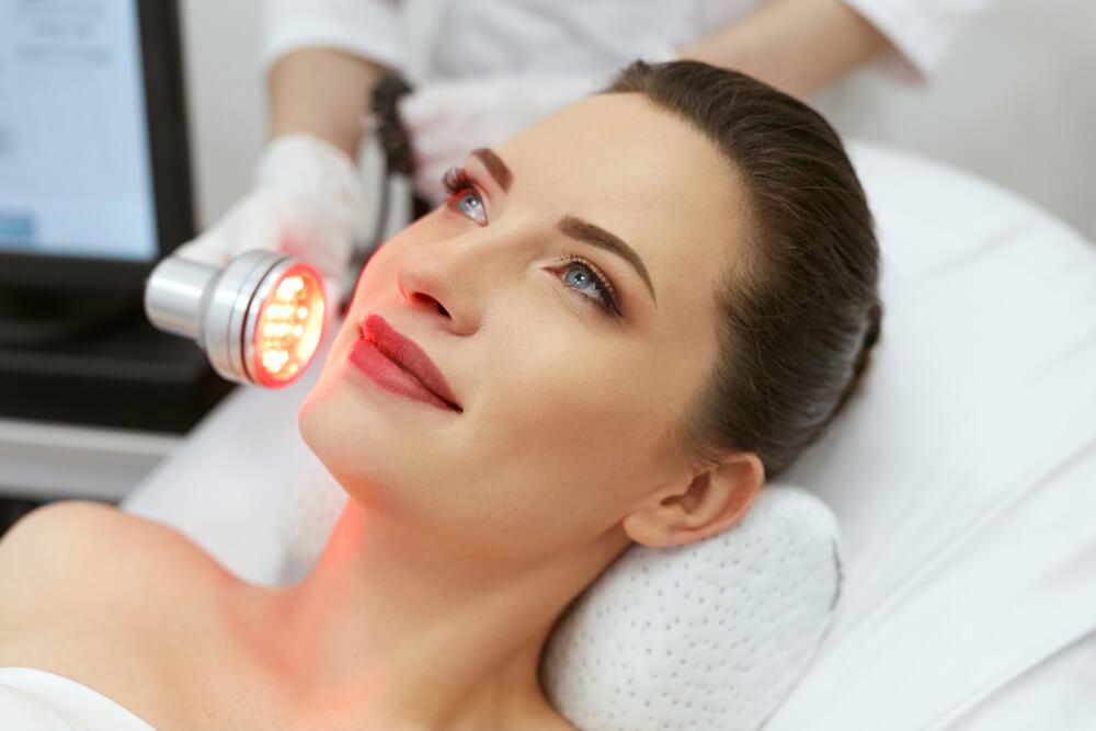 Woman having LED skincare treatment