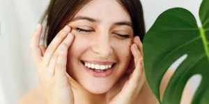 Woman touching skin around eyes